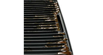 Sloped grill to drain excess fat away