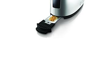Das einmalige Design der Toastkammer leitet mehr Krümel in die Krümelschublade.