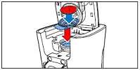 Placez le porte-dosette dans la machine à café LatteDuo