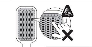 Ząbki podgrzewanej szczotki do prostowania włosów firmy Philips mogą być bardzo gorące