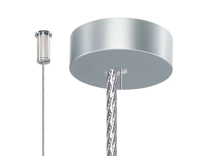 Set of two single steel wire suspensions with ceiling fixation (SM2). One ceiling cap is included for the metal-like power cord. The set is delivered as part of the suspended luminaire.