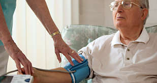 Monitoring an elderly man's blood pressure