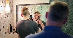 Young man's first shave
