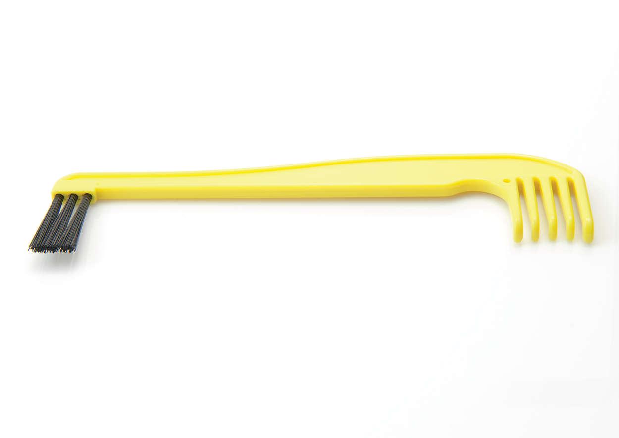 Pour nettoyer la brosse rotative et le compartiment à poussière.