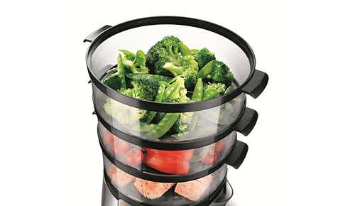 La capacità di 9 litri e i vassoi inferiori rimovibili consentono di cuocere un pollo intero