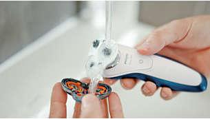 Le rasoir peut être rincé sous l'eau du robinet