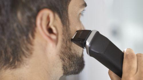 Přesný holicí strojek pečuje ookraje tváře, brady akrku.