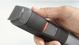 Luistamisen estävä kuminen kädensija helpottaa trimmerin käsittelyä