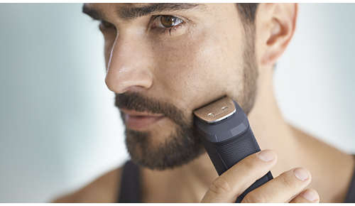 Metalowy trymer dokładnie przycina brodę oraz włosy na głowie i ciele