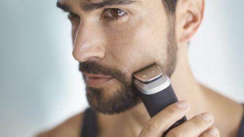Kovový zastřihovač precizně zastřihuje vousy, vlasy atělo