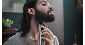 Металлический триммер точно моделирует бороду и подравнивает волосы на голове и теле