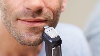 Přesný kovový zastřihovač zdůrazní linie plnovousu nebo bradky