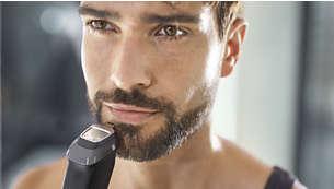 El recortador metálico de precisión define los bordes de la barba o la perilla