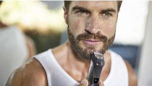 Natančni kovinski prirezovalnik oblikuje linije brade ali kozje bradice