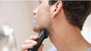 Alt-i-ett-trimmeren har ulike tilbehør som kan brukes for å trimme skjegg og fjerne nese- og ørehår.