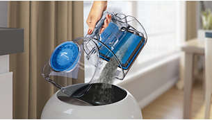 Dust container designed for hygienic emptying with one hand