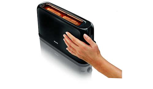 De buitenkant van het broodrooster blijft koel en kan veilig worden aangeraakt