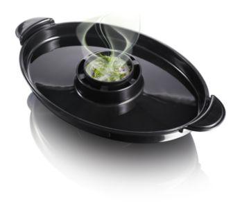 Komora pre prísady Flavour Booster dodá jedlu viac chuti pomocou lahodnej vône bylín a korenín