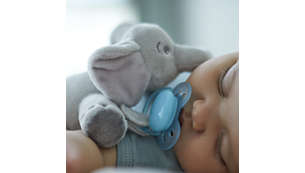 Plush toy helps keep ultra soft pacifier in place